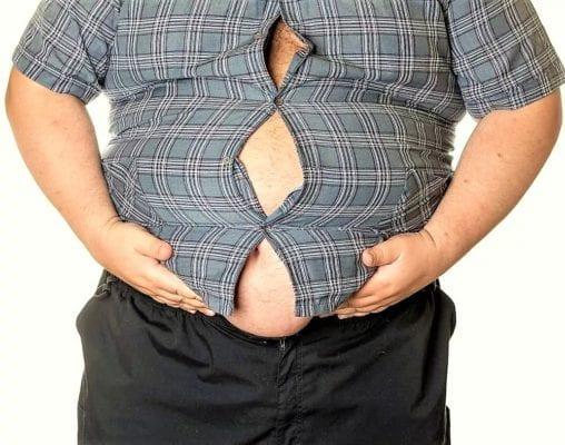 толстый держит пузо